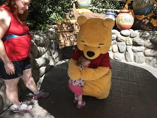 Hugging Winnie the Pooh