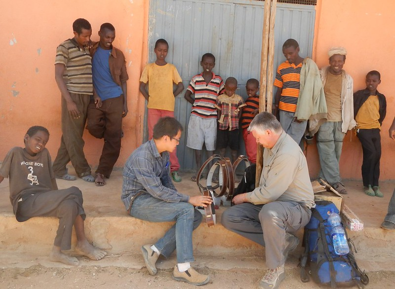 Field team testing GPS collars in the field before deploying them on cows in Wachille, Borana.