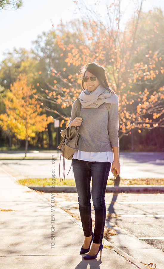 gray scarf, gray button back sweater layered over baby blue peplum top, skinny jeans, gray moto bag, blue suede pumps
