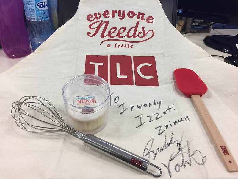 His autograph and some goodies from TLC including an apron