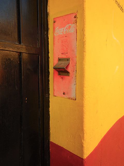 Bright wall with a faded Coca-Cola opener in Talpa, one of Mexico's Pueblos Magicos in the Pacific high sierras