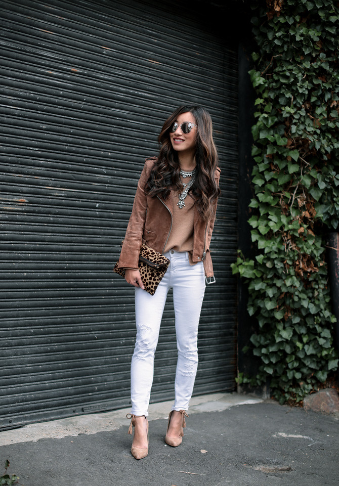 fall outfit idea suede moto jacket white jeans