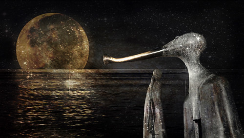 Supermoon over water with Colunga 'magic-realism' sculptures from Puerto Vallarta, Mexico