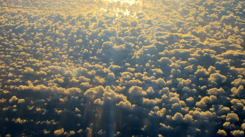 Views from the journey home, as we climbed over Denmark, the sun rose in the east, casting strong long shadows down below.