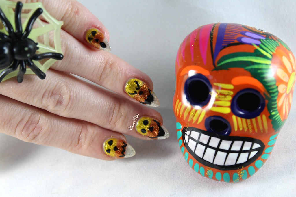 Candy corn jack-o-lantern nail art for Halloween