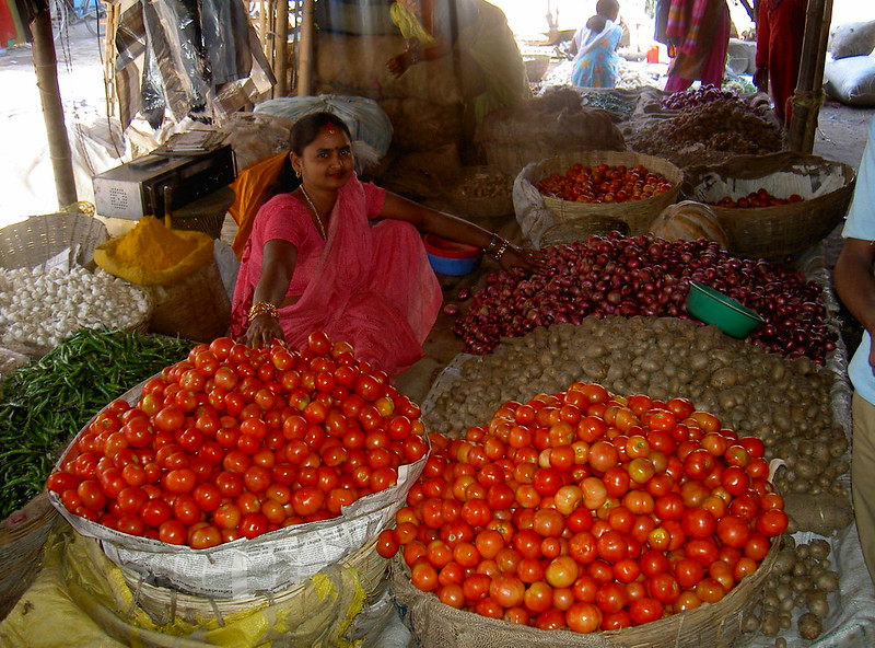 A Taru woman selling homegrown produce at a local market in Rajbiraj, Nepal.