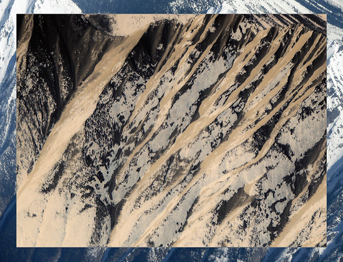 Aerial shot of snow on the mountains overlaid in Photoshop