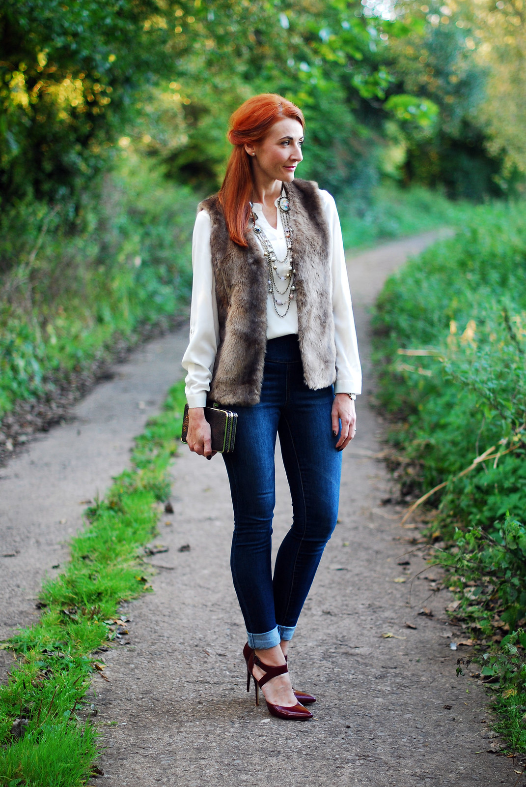 Faux fur gilet, skinnies and heels