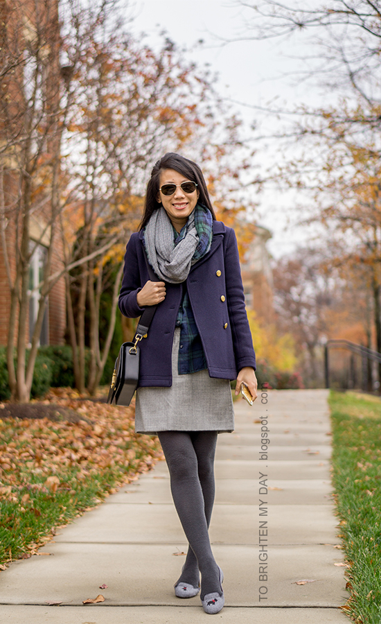 plaid and herringbone infinity scarf, navy peacoat, plaid button up shirt, gray wool skirt, tights, flannel flats with embroidered scotty dog