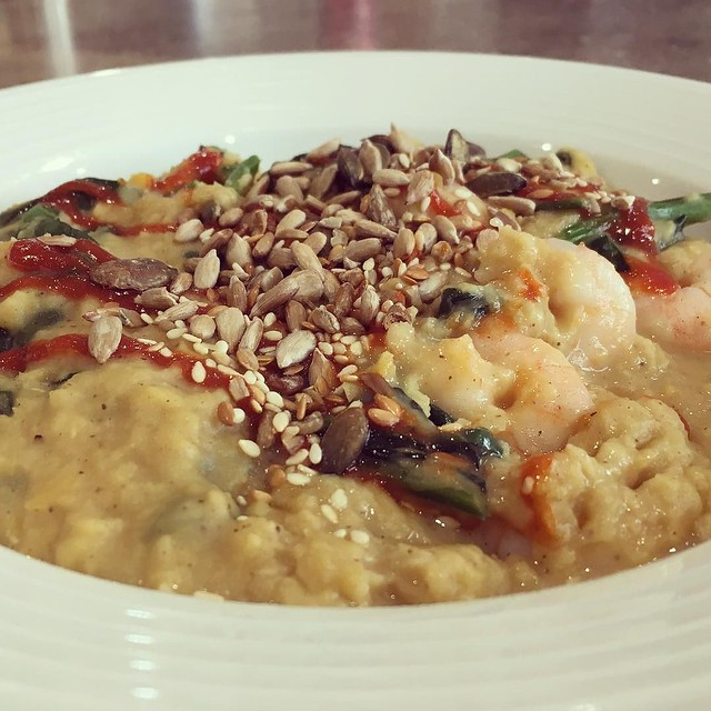 Comfort food lunch right here: coconut milk & lentil daal with spinach & prawns mixed through, topped off with toasted seeds and sriracha.