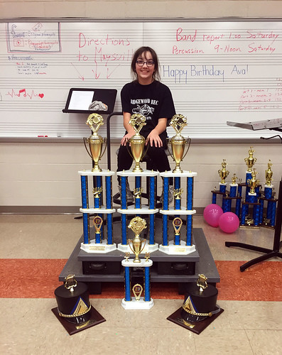 Julia and the band's trophies from Saturday's Band-A-Palooza competition in Maysville