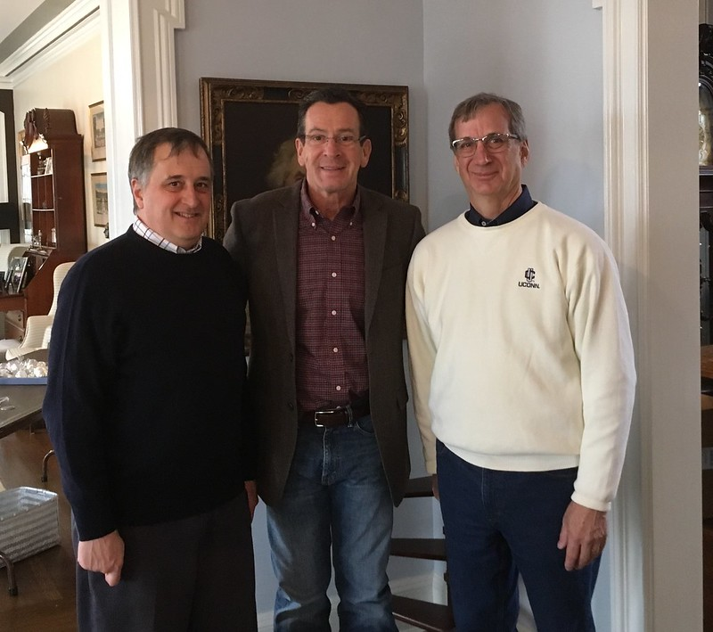 Left to right: Associate Dean Cameron Faustman, Gov. Dannel Malloy, Dean Gregory Weidemann. Students and volunteers from the College decorated the Governor's Residence on Sunday, November 27. Photo by Bonnie Burr.