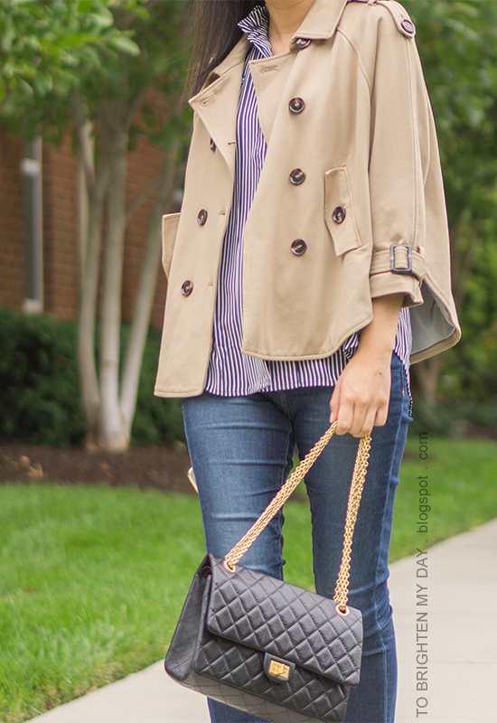 camel trench cape, navy striped button up shirt, skinny jeans, black shoulder bag