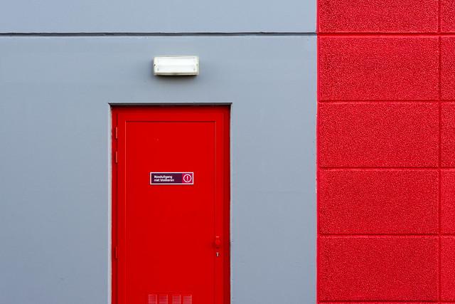 Red door and grey wall