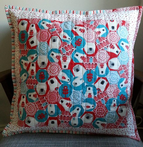 My first #Christmascushionalong cushion is finished! I hand pieced the hexagons, attached the borders on the machine and machine quilted the front and back. I didn't have enough of the stripe to get all the way round, so added the red snowflake to make up