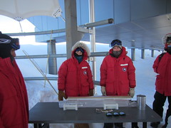 Murat Aydin, Emma Kahle, Jay Johnson, and Josh Goetz (and Joe Souney, not shown) present a 1-meter-long section of the South Pole Ice Core to the National Science Advisory Board