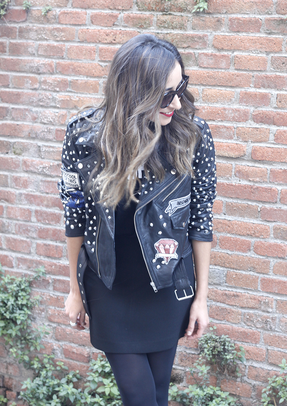 Leather jacket with studs and patches black skirt heels style fashion outfit06