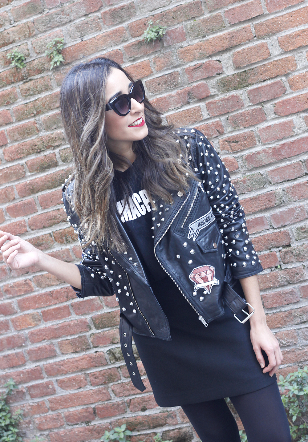 Leather jacket with studs and patches black skirt heels style fashion outfit08