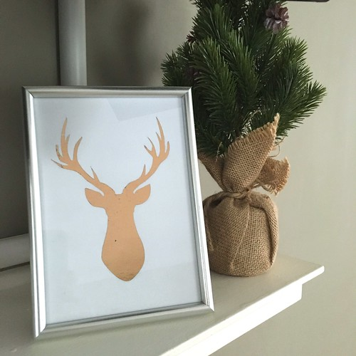 Rose gold reindeer on mantle