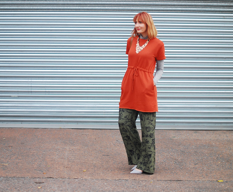 A rust t-shirt dress layered over grey roll neck, khaki floral wide leg pants, autumnal tri-colour leaf necklace | Autumn style | Fall outfit | Layering | Not Dressed As Lamb, over 40 style