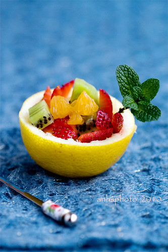Fruit salad in lemon bowl | by anhsphoto_busy!!