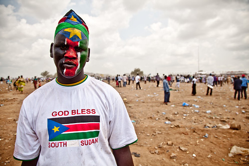 Man paints face in South Sudanese colors | by ENOUGH Project