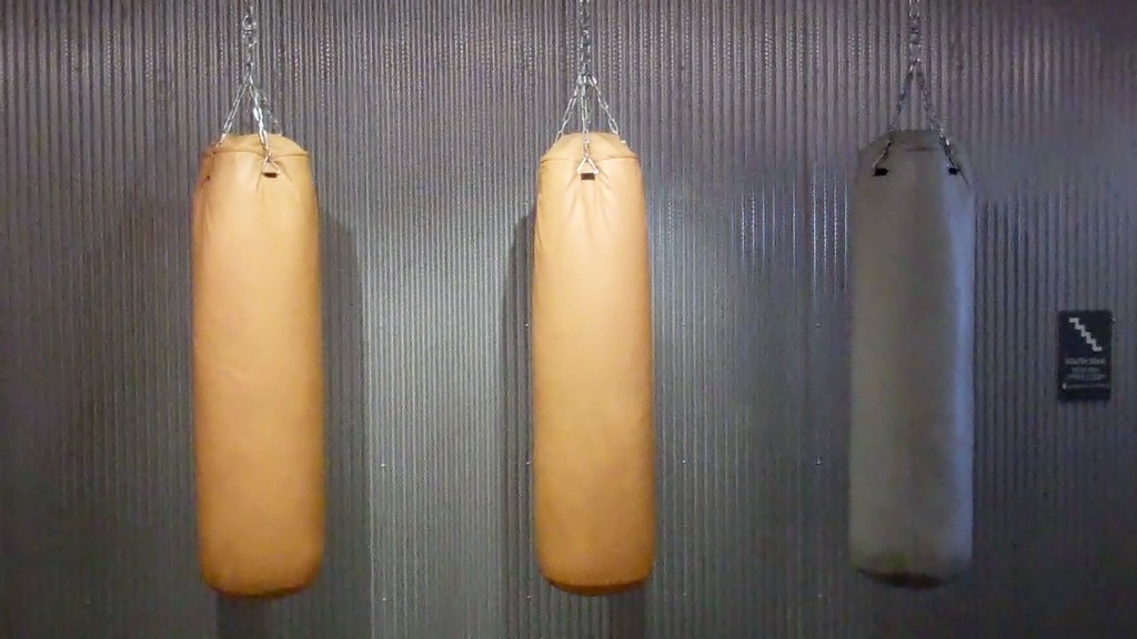 three punching bags