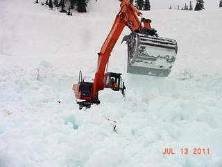 Excavator digging through the snow | by WSDOT