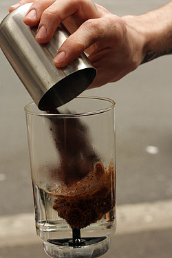adding coffee to siphon coffee | by David Lebovitz