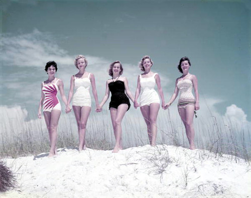 Unidentified young women modeling on a sand dune at the beach: Panama City, Florida | by State Library and Archives of Florida
