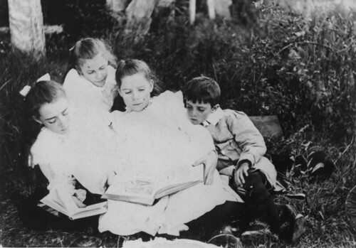 Group of children sitting on the grass reading books, 1900-1910 | by State Library of Queensland, Australia