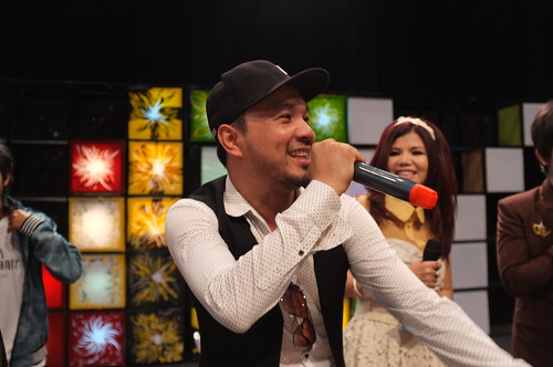 Loy9 TV Show - Dj Khliang (in hat) and Meas Skosophea singing the theme song - Jan'12 | by United Nations Development Programme