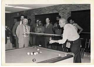 Mayor Kevin H. White plays pool, ca. 1971-1974