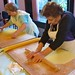 La sfogliena and nonna rolling pasta dough