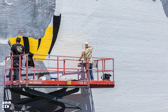 UK street artist Dface at work on a mural in a lift for Mural Festival in Montreal