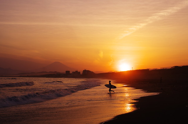 surfer at the sunset beach