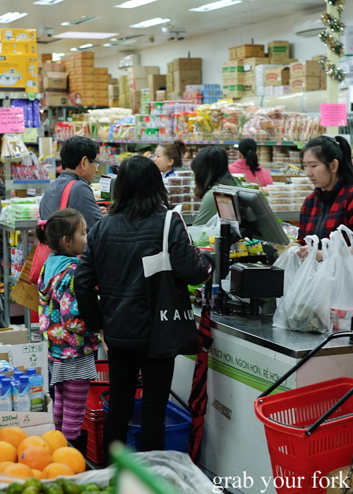 Customers at the registers at Save More Asian grocery store during the Community Kouzina Marrickville Food Tour for Open Marrickville