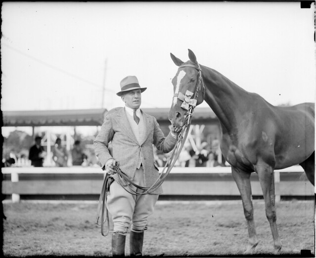 Danny Shea holding Hugh Bancroft, Jr.'s Pastime at Brockton Fair. Horse is prize jumper.