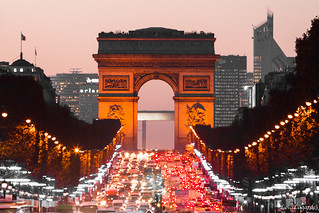 Arc de Triomphe and Champs-Elysées avenue with christmas 2011 lights at dusk, La Defense financial district in the background. | by Loïc Lagarde