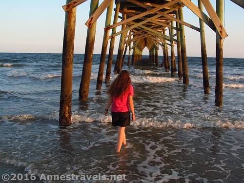 Walking under the pier at sunset, Holden Beach, North Carolina