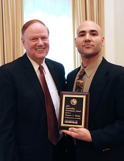 President Ramsey awards Charles Nasby