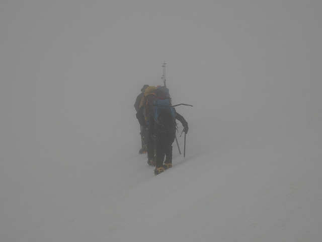 climbers in whiteout