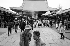 Two women and crowd at Sensō-ji Temple, Asakusa, Tokyo