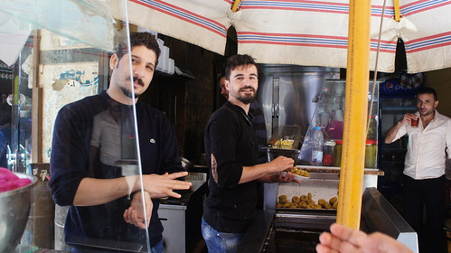 Two Syrian young men working in ful and falafel restaurant