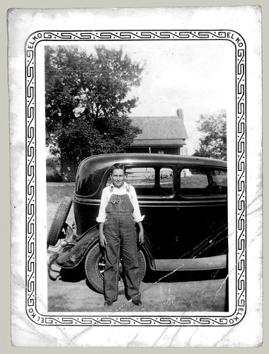 Boy, bib overalls, car
