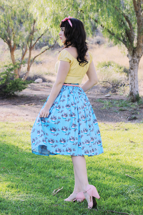 Pinup Girl Clothing Pinup Couture Jenny Skirt in Mary Blair Grey Cat Print Peasant Top in Yellow
