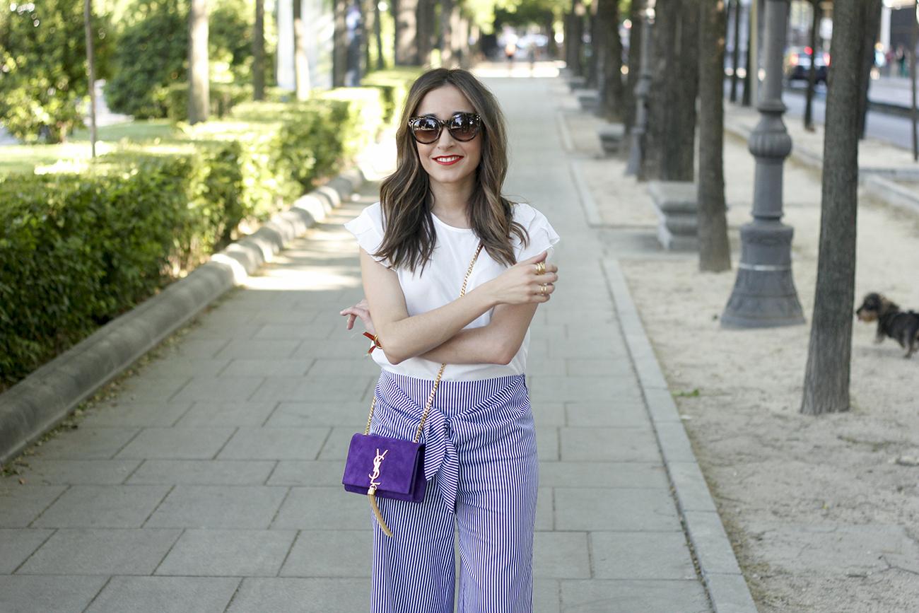 striped pants with bow white shirt carolina herrera sandasl saint laurent bag accessories summer outfit10