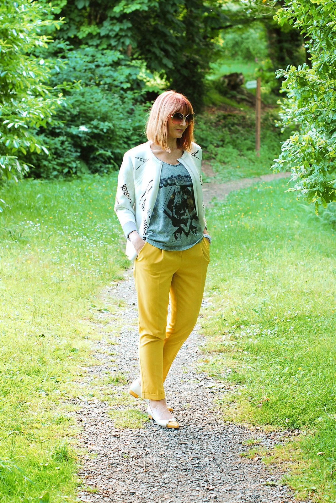 Dressed for a cool British summer: White scuba jacket, grey rock t-shirt, yellow tailored trousers, pointed two-tone flats | Not Dressed As Lamb