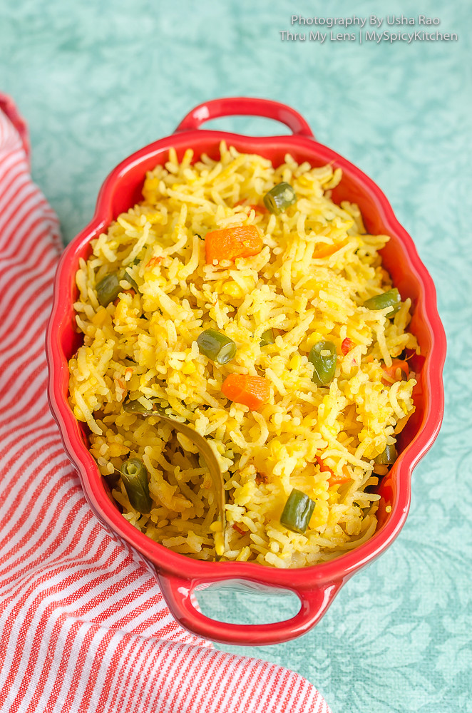 Protein Rich Food Moong dal vegetable rice in a red serving dish