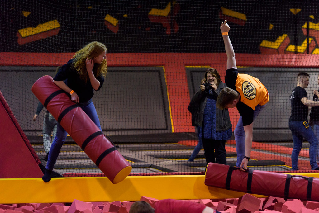Young people playing in foam pit